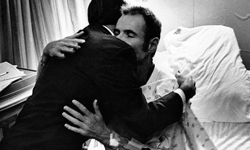 Men embrace 1982: The first case of AIDS in Canada.