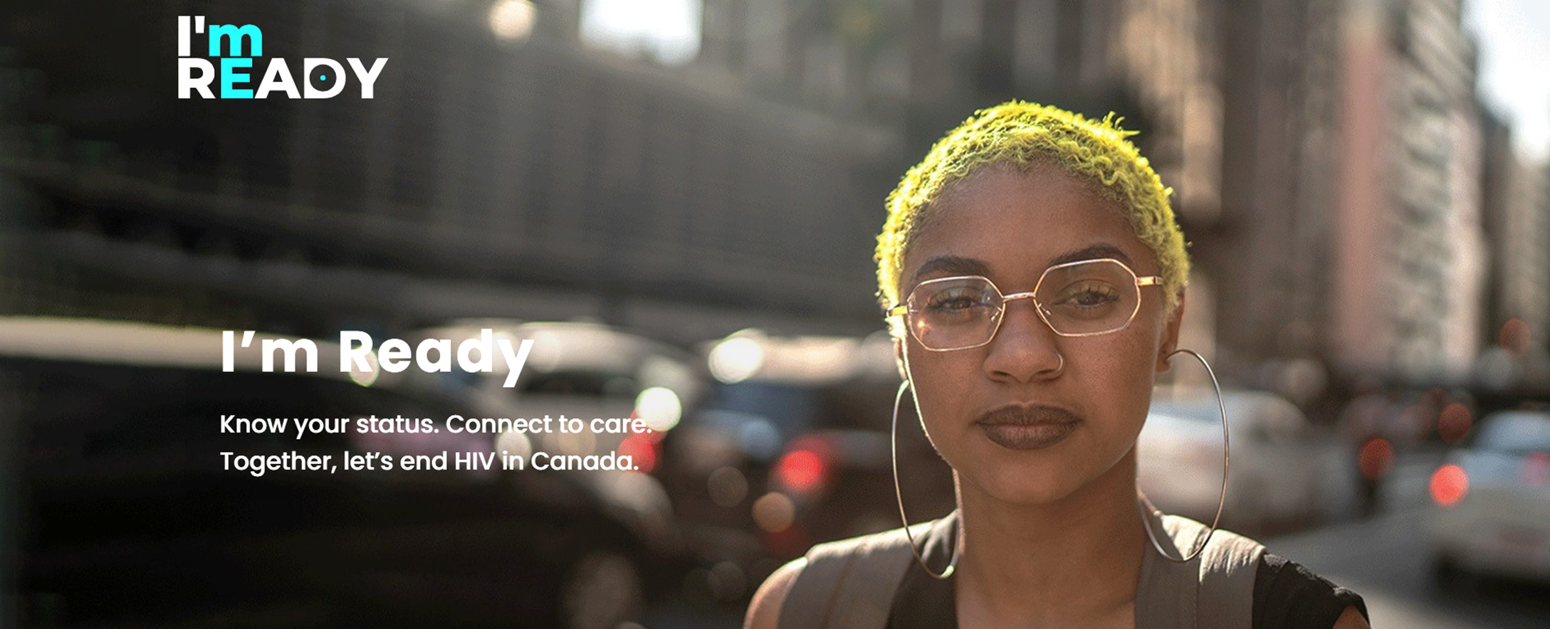 Image of woman wearing glasses with yellow hair staring at the camera